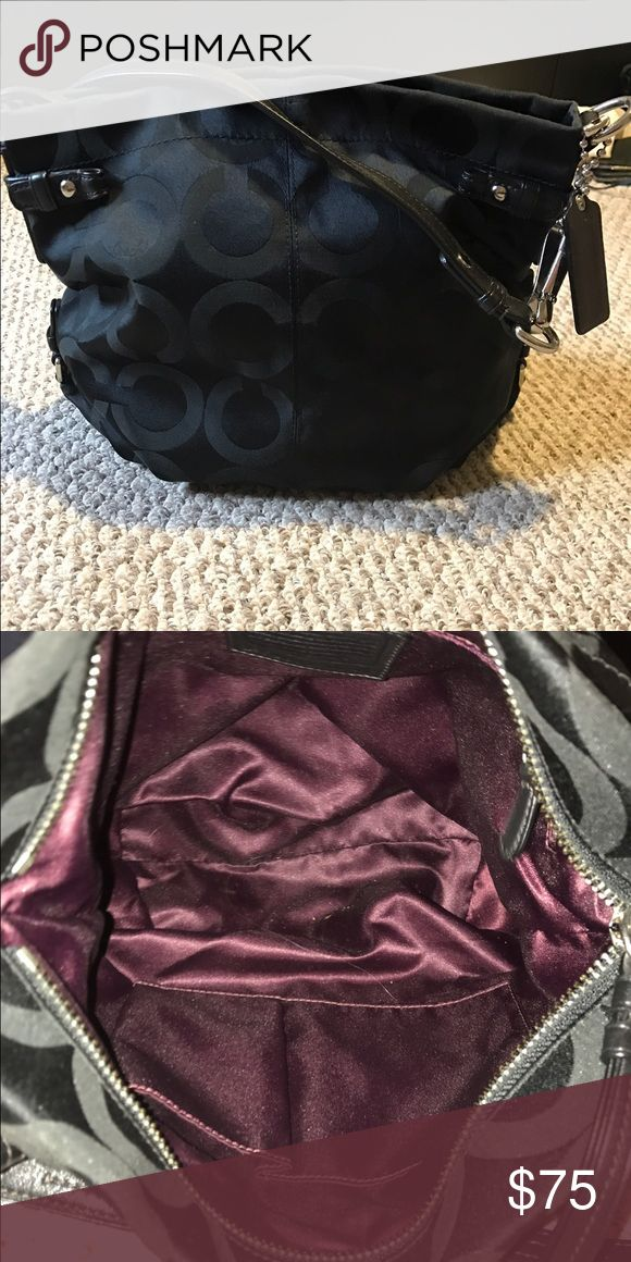 Black coach Purse Blacked coach Purse, maroon/purple interior. Comes with dust bag! Coach Bags Shoulder Bags