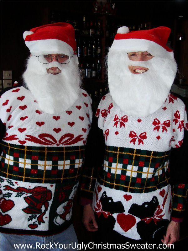Mr. & Mrs. Claus in their '1st Place Couples' Matching Ugly Christmas Sweaters