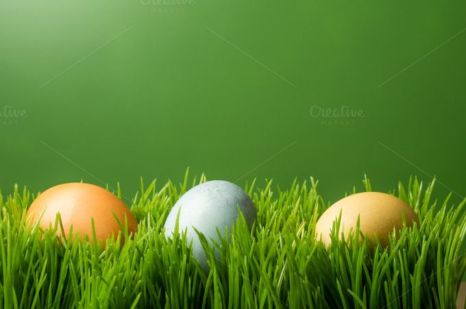 Easter eggs on grass by Zigzag Mountain Art on Creative Market
