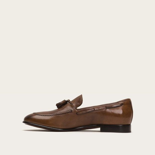 $398.00 FRYE Tassel Loafer SOLD by FRYE - AIDEN TASSEL The loafer that's all about luxury. Handcrafted from tumbled and waxed Italian calf leather, this lightweight moc-inspired dress shoe with lace-through detail and hand-tied tassel offers unparalleled flexibility while the beautifully antiqued finish provides handsome character and timeless wear. Part of our Made in Italy Collection. - Italian Leather - Made in Italy - Raw Hide Laces