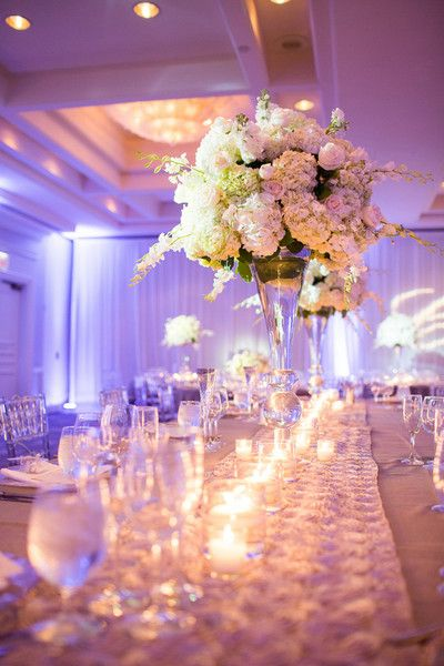 Glam wedding centerpiece idea - tall glass centerpiece with white hydrangeas and candles {Thompson Photography Group}