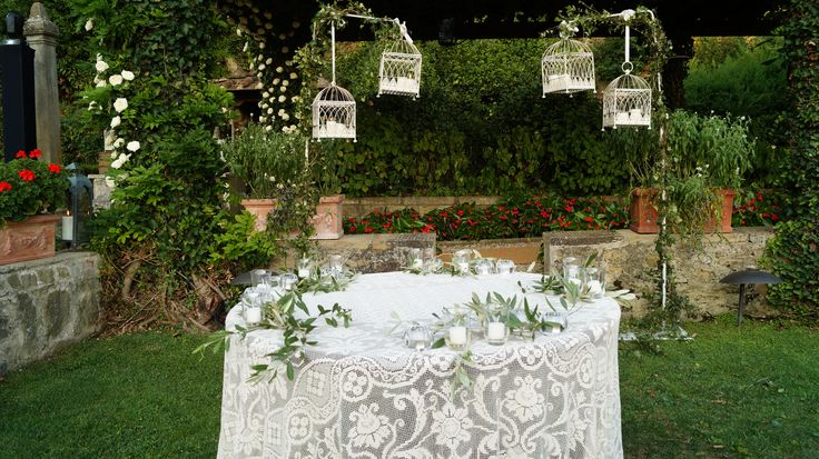 #FLORALIADECOR #GIRITALY #CakeArea #Cages #Candles #LaceTablecloth #OliveBranches