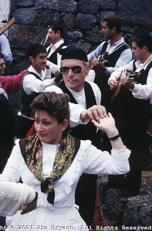 Villagers, dressed in traditional clothing, participate in traditional dances during the festival 'Divino Espirito Santo' which begins on Pentecostal Sunday and last till the end of summer on Terceira, Azores. Far out in the Atlantic Ocean, some 850 miles off the western coast of Lisbon, Portugal lies the 425-mile long archipelago of the Azores. (Jim Bryant Photo)....