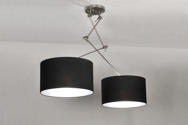 Nieuwe trend! Een draaibare, extra lange en verstelbare 2 lichts hanglamp in een grote uitvoering. Het armatuur wordt geleverd met twee mooie zwarte stoffen kappen. De binnenkant van de kappen zijn wit. De extra lange stang is in hoogte verstelbaar. Door de diverse verstelmogelijkheden van dit armatuur kunt u zowel stang als kap kantelen naar uw eigen gebruiksvoorkeur. Deze lamp is tevens draaibaar op de plafondplaat, dit in tegenstelling tot andere modellen in de markt.