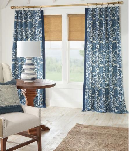 Add texture and visual interest to your home with this bordered, Indonesian-inspired fabric, available in a rich and bold Navy Blue. (Country Curtains Royal Batik Lined Rod Pocket Curtains.)