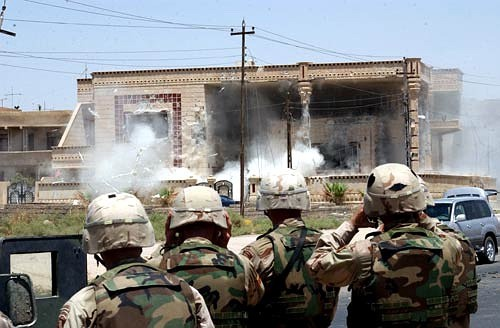 Soldiers with the 101st Airborne Division (Air Assault) watch as a TOW missile strikes the side of a building that is suspected of harboring Uday and Qusay Hussein in Mosul, Iraq, July 22, 2003. Qusay and Uday were killed in a gun battle as they resisted efforts by coalition forces to apprehend and detain them. U.S. Army photo by Sgt. Curtis Hargrave