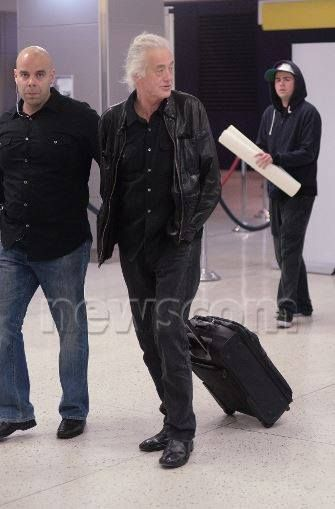 Jimmy Page and his bodyguard at the airport, May 22, 2014 returning to London
