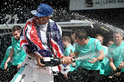 Lewis Hamilton / Mercedes GP celebrates his win with his team during the British F1 Grand Prix at Silverstone