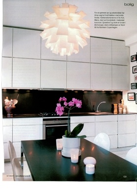 White cupboards, black splash back.