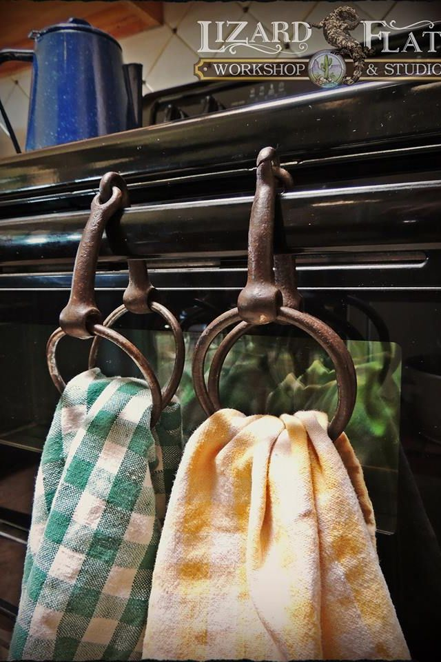 Great use for old snaffles - hold dish towels. put over handle on oven door