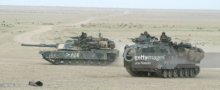 M1A1 ABRAMS & AAVP7A1, USMC  S. Marine armored attack vehicle and an M1A1 Abram tank of Task Force Tarawa roll through the Iraqi countryside March 21, 2003 on their way to an objective in Iraq. U.S. President George W. Bush began a war against Iraq to oust Iraqi President Saddam Hussein.