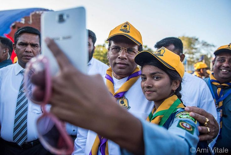 Photo by @amivitale on assignment for @natgeo. President of Sri Lanka Maithripala Sirisena takes a selfie with Sanjita from Bangladesh during the opening of the ninth National Scout Jamboree organized by the Sri Lanka Scout Association in Jaffna. Approximately 9125 Scouts from 11 countries are taking part in the Jamboree. This is the first time a National Jamboree was held in Sri Lanka's Northern Province. Follow @amivitale for more behind the scenes of my @natgeo story…