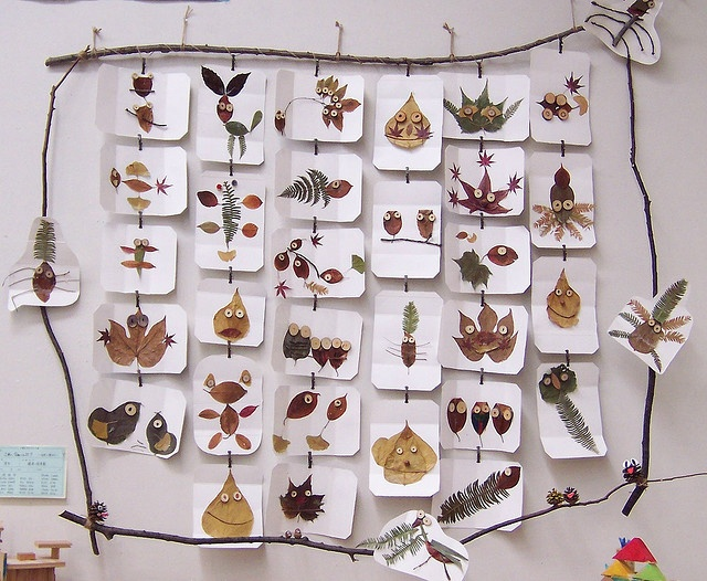 leaf people/animals. love the twig frames ! Beautiful nature stuffs on webpage!