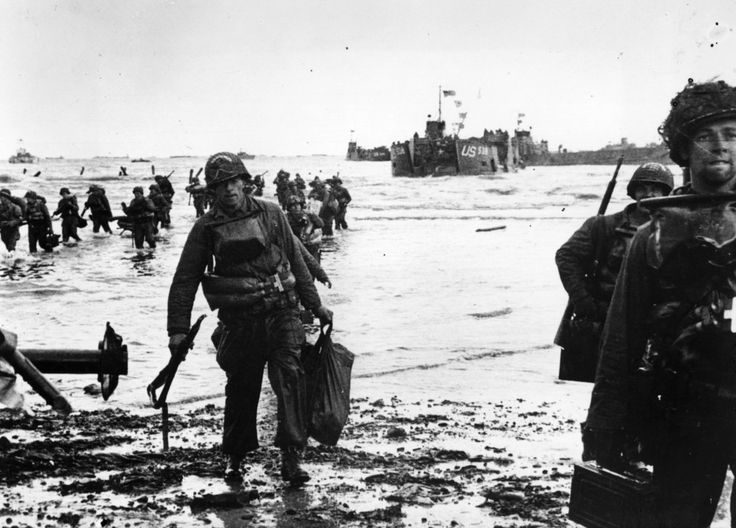 The barrage of German fire takes a heavy toll. | Amazing, Historic Images Of Allied Troops Storming The Beaches Of Normandy On D-Day