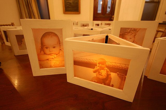 Print photos on vellum and use inexpensive frames.  Lit by a votive candle.  ***Great for engagement photos!