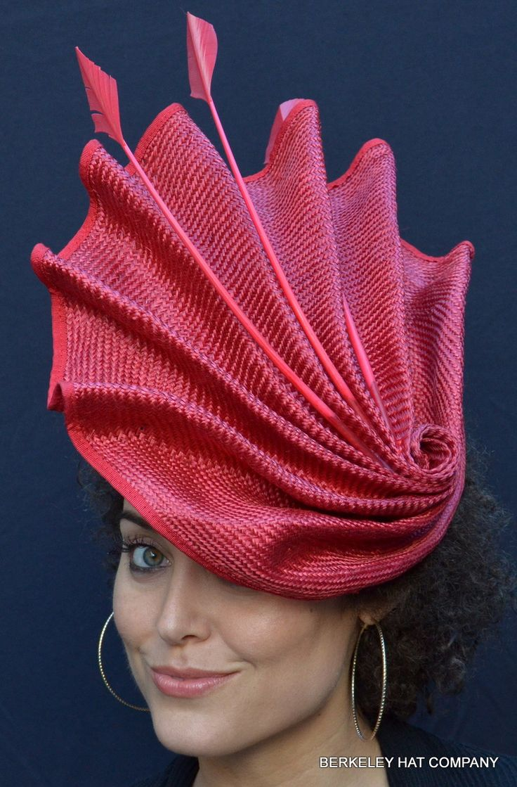 The Quintessential Red Fascinator [worn by a woman with a stupidly inappropriate expression and no taste regarding earrings suitable for such a masterpiece]