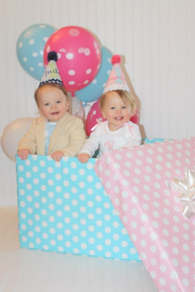 Twins 1st birthday picture. They want to go 2 different directions so wrapped a huge box & put them in it. :) :)