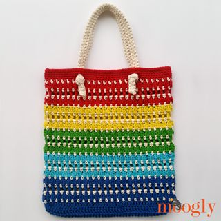 I love crocheting tote bags - they are super handy, fun to crochet, and make great gifts! And I had a lot of fun playing with the colors and stitches in the Knotted Rainbow Tote Bag - a free crochet tote bag pattern here on Moogly!