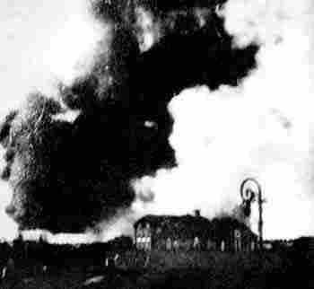A fire rages inside the Warsaw Ghetto.