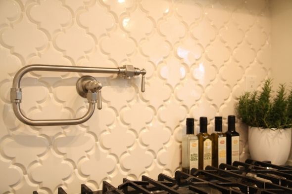Break away from the standard subway tile shape, and embrace the ornate beauty of our award-winning Beveled Arabesque. This glazed ceramic tile is unique in shape, and creates a custom look to any kitchen or bathroom. Whether your style is classic, contemporary, or eclectic, you can instantly update your space by incorporating our Beveled Arabesque into your kitchen as a backsplash, or create a feature wall in your bathroom.