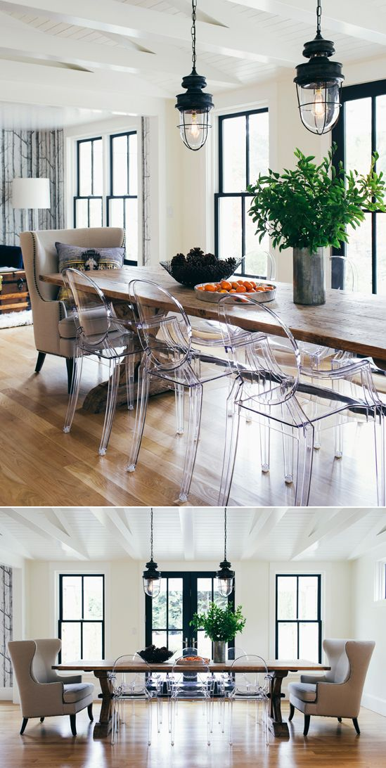 industrial lights and wood table and clear ghost chairs in dining room | via h2 design and build