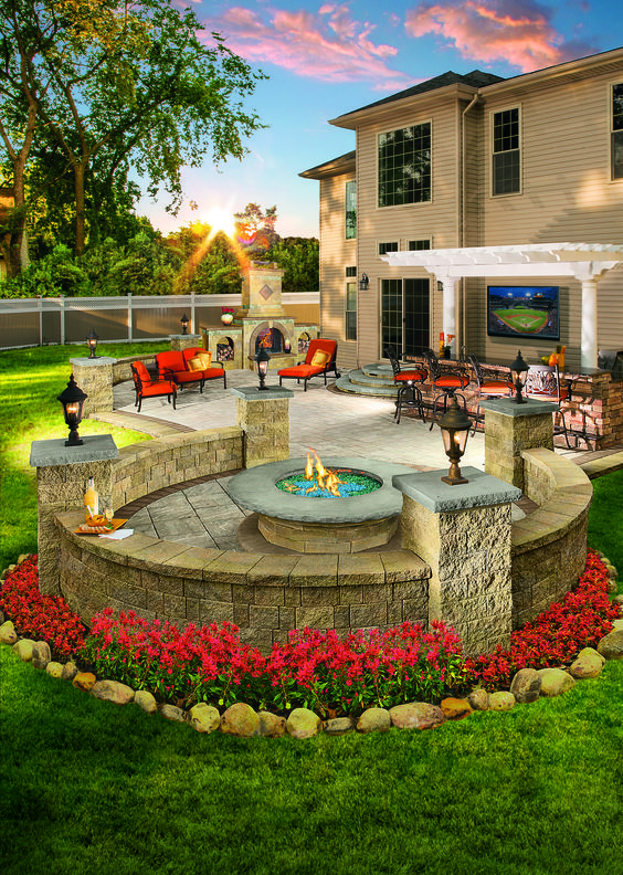 Outdoor patio area with outdoor dining and fire place for a modern home | Kanler.com