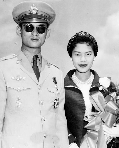 His Majesty King Bhumibol Adulyadej of Thailand and Queen Sirikit at Logan International Airport in Boston.
