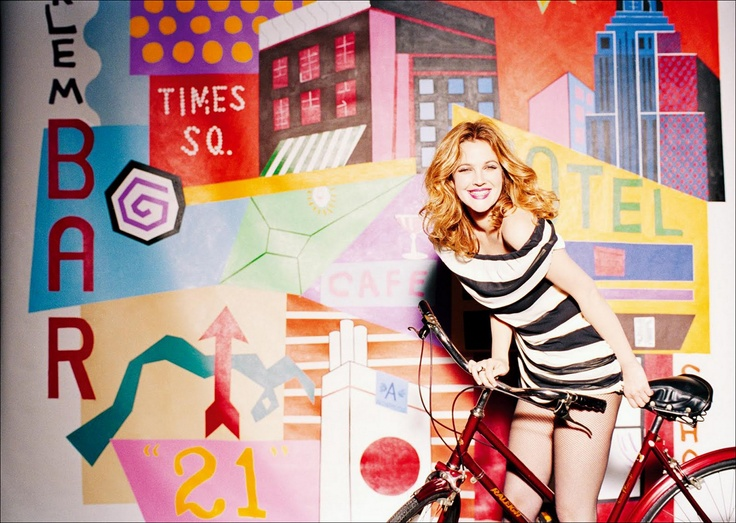 Drew Barrymore on a bicycle