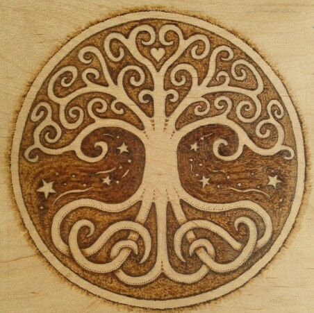 Magical Tree of Life centered around the heart, branches mingling with the stars and roots deeply twisted into the earth. Woodburned with warm, earth tone by New England artist, Jason Gianfriddo