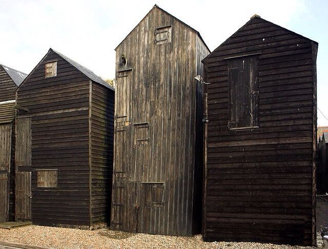 old fishing huts hastings seafront uk these were made tall so the fishermen could dry and. Black Bedroom Furniture Sets. Home Design Ideas