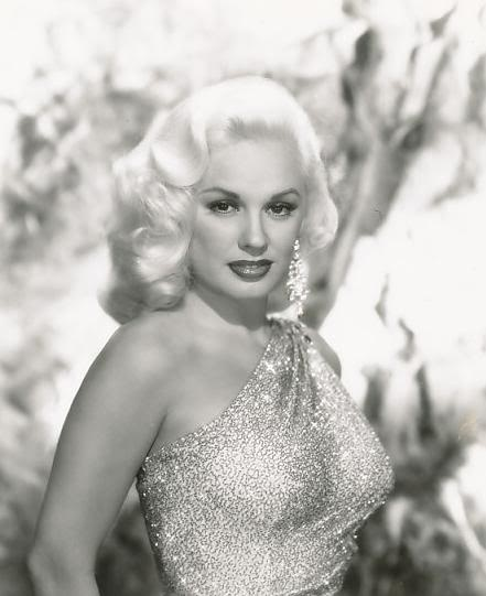 Mamie Van Doren in glittery single shoulder dress