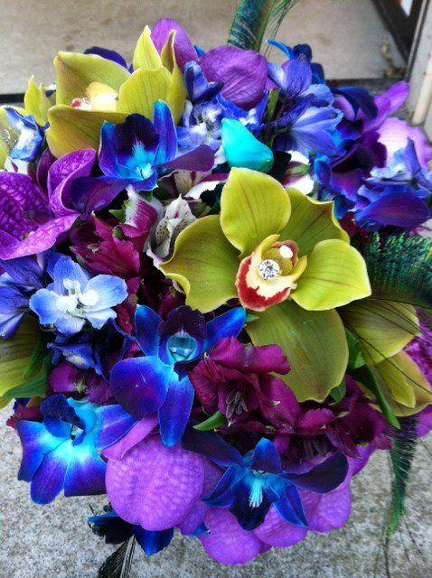 Bridal bouquet - cymbidium orchids, blue Bella Donna, dyed dendrobium orchids, alstroemerias , and purple vanda orchids