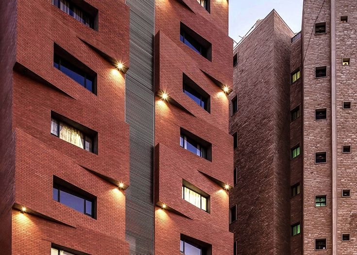 modern brick apartment building. Edges Apartments resembles a tower of offset brick blocks  Brick block Facades and facade