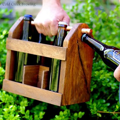 BYOB Wooden Bottle Holder with opener ... could also be a gift for a Beer or Soda Pop fan.