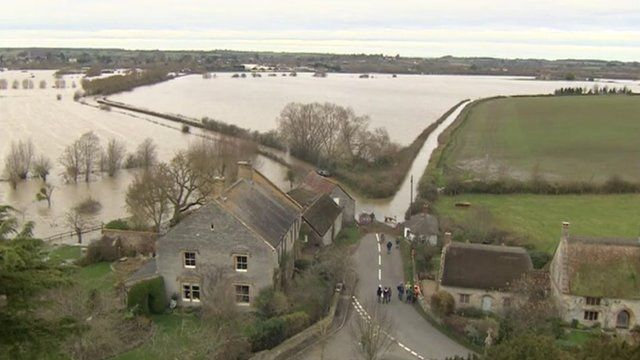 uk ireland flooding | UK floods: Rescue boat take villagers to buy supplies