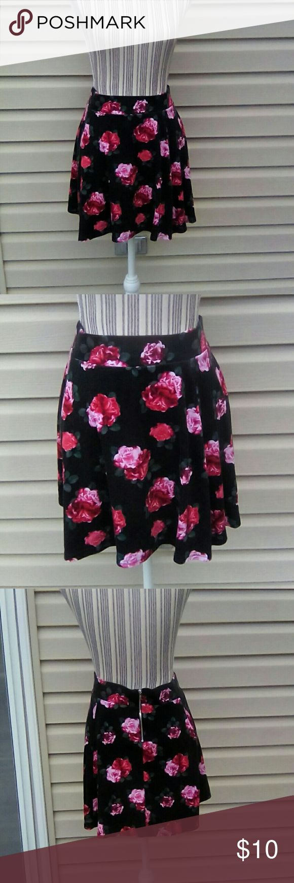 H&M Divided Black w/Roses Skirt Sz Large H&M Divided Skirt. Black with red and pink roses. It has a zipper down the back. Polyester/Elastin/Viscose Blend. Size Large. Very cute. Can be dressy or casual. Worn about 5 times. Smoke free home H&M Divided Skirts