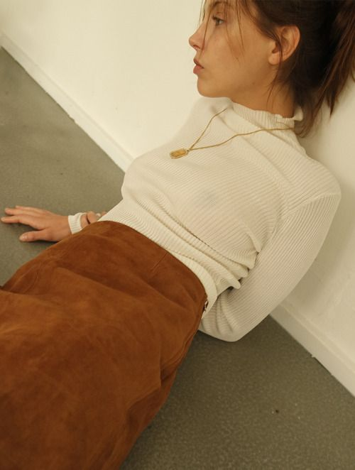 high neck white jumper, tan suede skirt and necklace