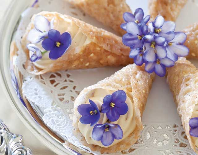Brandy Snaps with Lady Grey Cream. Add a little crunch to your dessert tray with these beautiful brandy snaps. Filled with Lady Grey Cream and garnished with fresh violets for an air of elegance.