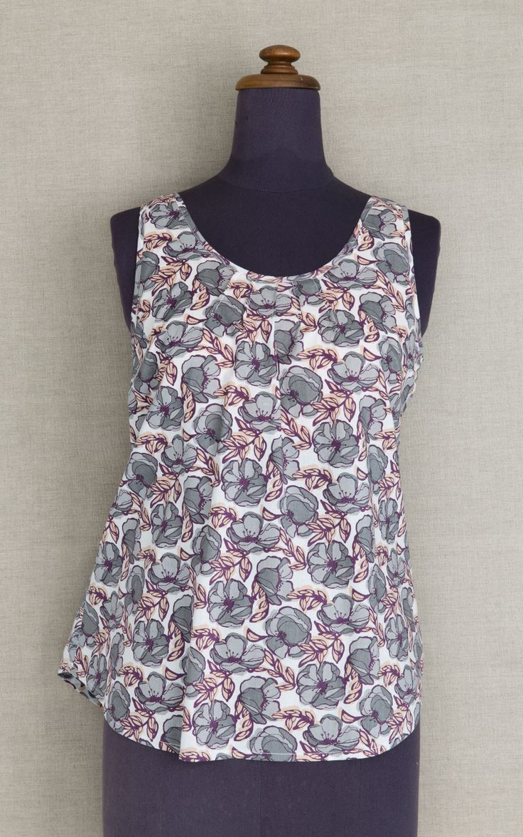 Moonbird Sylvie print cotton pyjama top. Moonbird loose vest top with pintuck detail around the front neckline is made from soft 100% GOTS certified organic woven cotton, with hidden support layer made from cotton lycra. Moonbird garments are assembled in a Fair trade facility in jaipur, India. $50 AUD