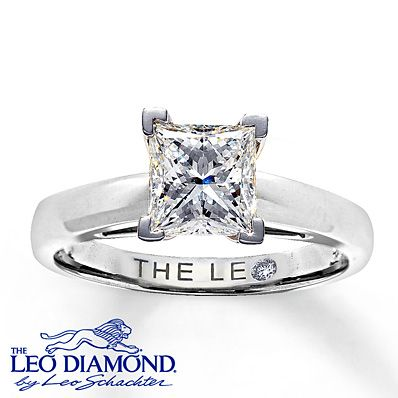 A breathtaking 1 1/2 carat princess-cut Leo Diamond is set in a band crafted of 14K white gold in this stunning diamond solitaire ring for her. The diamond is independently certified and laser-inscribed with a unique Gemscribe® serial number.