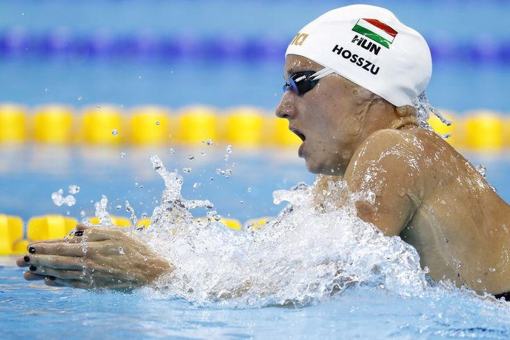 Hungary's Katinka Hosszu takes part in the Women's 400m Individual Medley heat during the swimming event at the Rio 2016 Olympic Games at the Olympic Aquatics Stadium in Rio de Janeiro on August 6, 2016.   / AFP / Odd Andersen