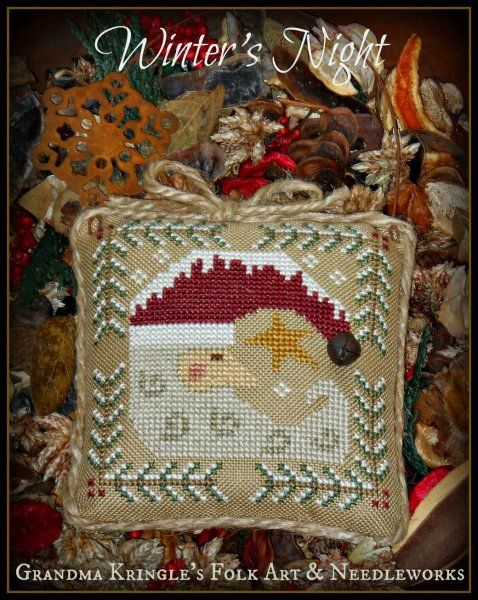 Winter's Night is the title of this cross stitch pattern from Grandma Kringle's Needleworks that features Santa that is stitched with DMC threads.