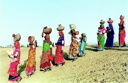 In developing countries, people (usually women and children) often must walk long distances to find water. These village women from Pakistan's southern Sindh province embark on a water search, carrying traditional earthenware pots in addition to their small children.