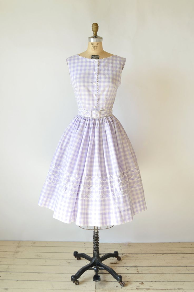 Vintage 1950s skirt and blouse set. Lavender and white cotton gingham. Fitted bodice that fastens up the front with white crochet buttons. Scoop