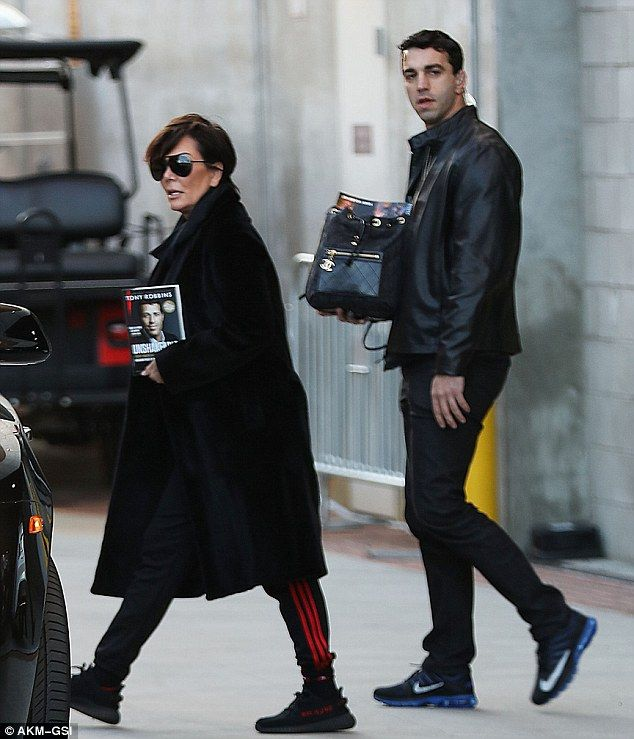 Nice purse holder:Kris Jenner clutched Tony Robbins' third self-help book while leaving h...