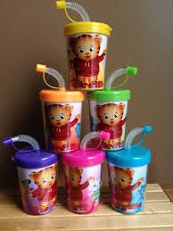 Daniel Tiger's neighborhood cups...look for some decorate-yourself cups and print Daniel decorations for the inserts.
