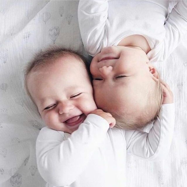 Twin babies. Smiling babies. Adorable babies.