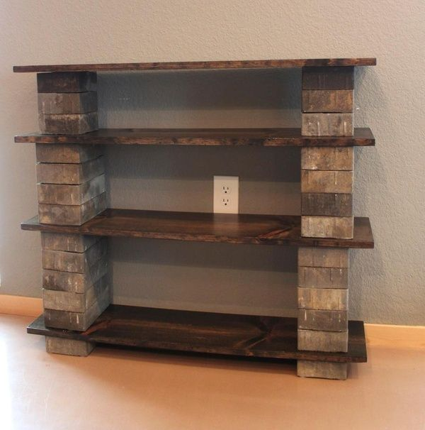 Make your own diy bookshelf out of concrete blocks and wood. A great idea for outside storage too.