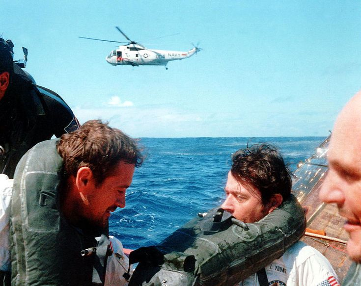 Apollo 16 Charlie Duke (left), John Young, and Ken Mattingly in the recovery raft.