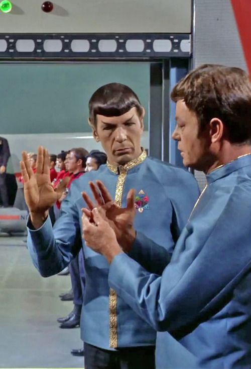 Spock Teaching McCoy how to offer the vulcan greeting.                                                                                                                                                                                 More